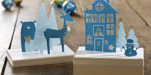 Ideen für Weihnachten: Winterweihnachtswunderland | Winterliche und weihnachtliche Szenen auf Pappboxen aus Papier mit Haus, Tannenbäumen, Sternen, Rentier, Bär und Schneemann